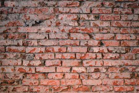 Old rough brick wall texture background front view. 版權商用圖片