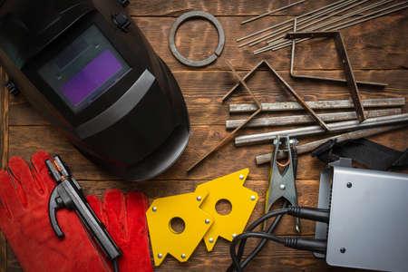 Welding equipment concept flat lay background.