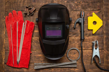 Welding equipment concept flat lay background.