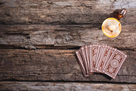 Tarot cards on the wooden table background. Future reading concept.