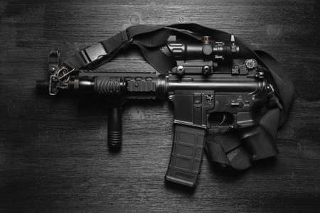 Airsoft rifle on the black flat lay background.