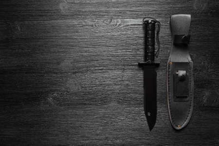 Military knife on the black flat lay background with copy space. 版權商用圖片