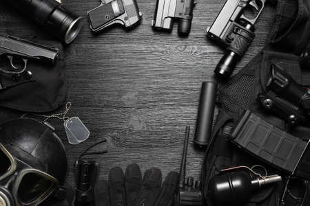 Airsoft equipment on the black flat lay background with copy space.