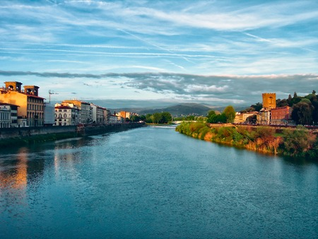 crepuscle: Sunset over the river in the Italian city