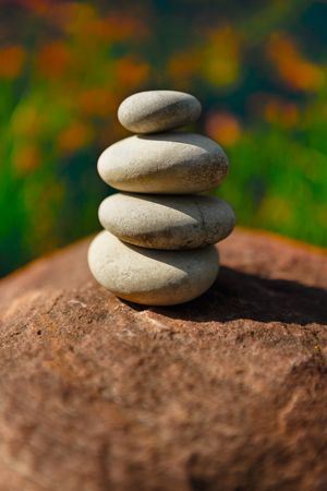 equipoise: Stones laid out in the form of a pyramid Stock Photo