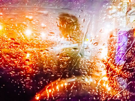 blurred image of lights of the city at night through the rain drops on the glass Stok Fotoğraf