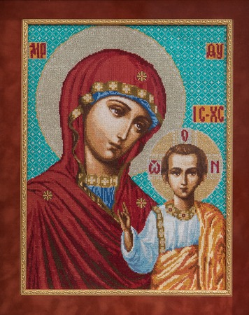 Icon Virgin. This photograph was taken from a picture, embroidered with a cross. Handmade.