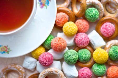 baranka: Cup of tea with colorful candy and baranka