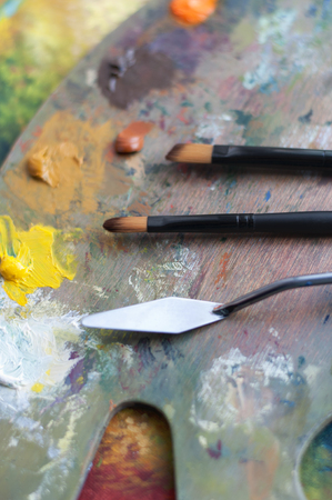 palette knife: Art palette with paint brushes and a palette knife