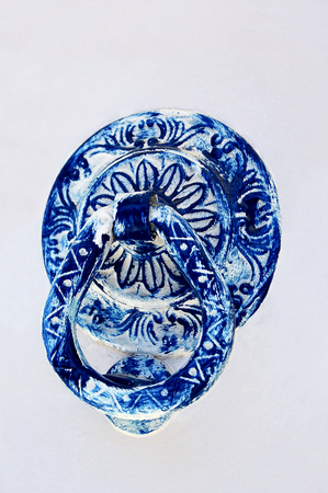 doorhandle: Blue door handle in oriental style on a white background Stock Photo