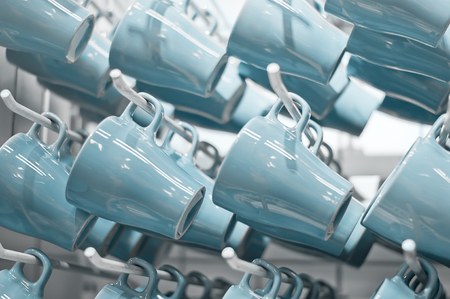 Number of blue cups hanging on display in the store Stock Photo