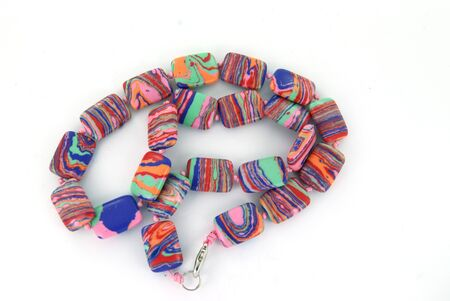 Colored beads necklace on white background