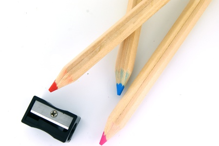 Pensils and a sharpener on white background Stock Photo