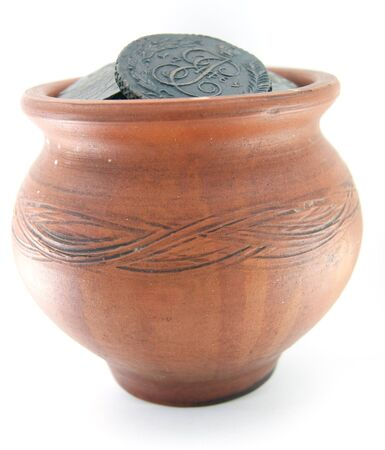 Clay pot with ancient copper coins