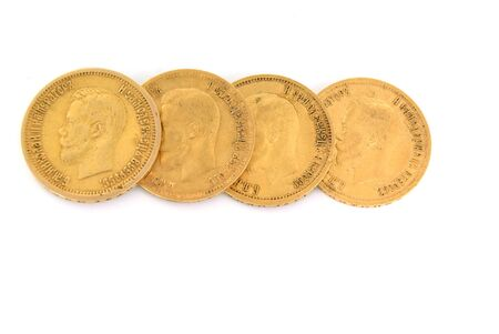 Four gold Russian coins in a row on white background