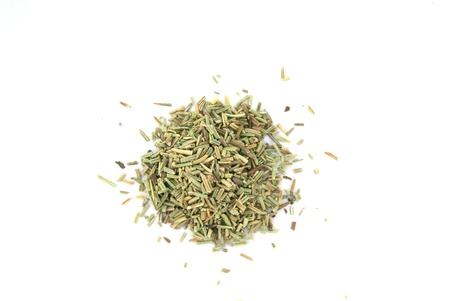 Oregano spice in a pile on white background