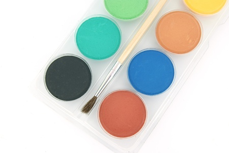 New watercolours for painting and a brush Stock Photo