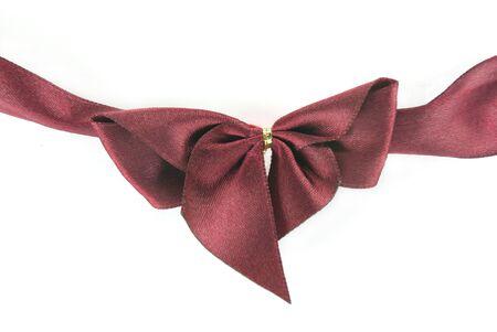 A dark ribbon bow on white background