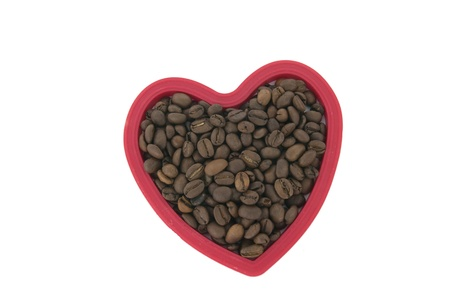 Red heart form full of  coffee beans Stock Photo