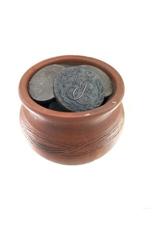 Old traditional clay mug with ancient Russian coins on white background Stock Photo