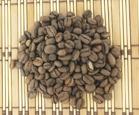 A heap of brown coffee beans on wooden background Stock Photo