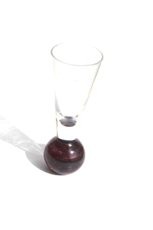 Colored brown wineglass on white background Stock Photo