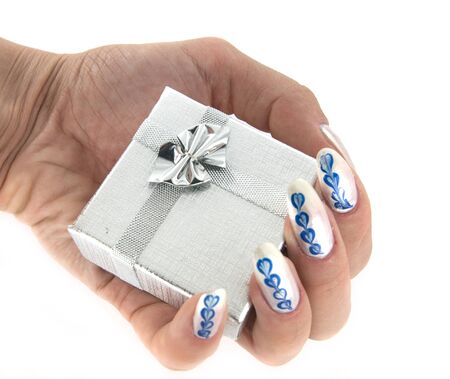 A woman hand holding a silver gift box