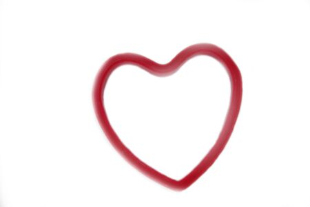 Isolated red heart over white