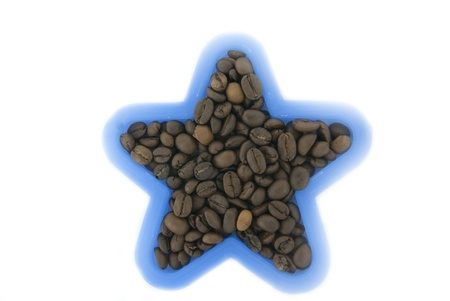 A blue plastic star with coffee beans