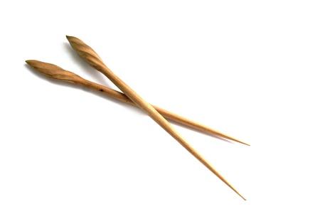 Hair wooden sticks on white background