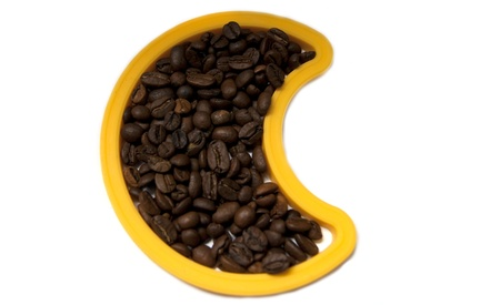 A yellow moon shape with coffee beans Stock Photo