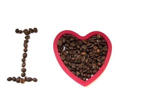 Coffee beans and a heart on white background Stock Photo
