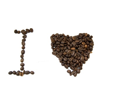 Coffee beans and a heart shaped on white background