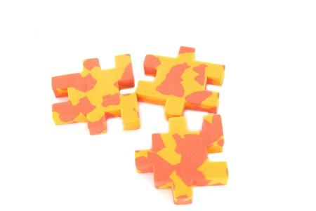 Three multicolored puzzles on white background Stock Photo - 10767650