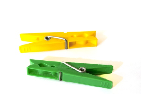 Two clothes pegs on the white background Stock Photo - 10767649