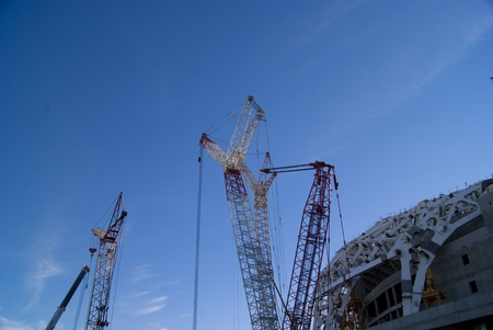 buliding: Construction site with big cranes and a part of the building Stock Photo