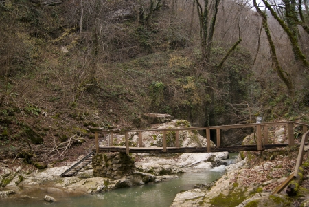 An old wooden bridge over the stream