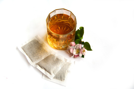 Cold apple tea, apple flowers and packets