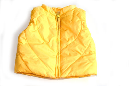 A yellow warm vest for a child on a white