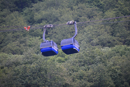 ropeway: Two ropeway cabins next to eaxh other in the summer