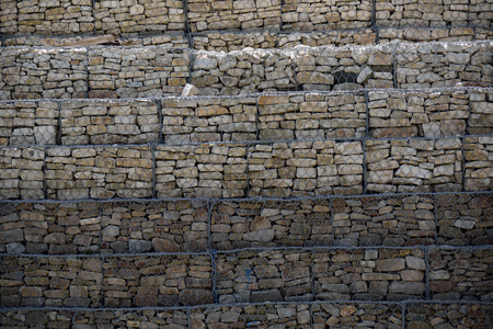 thicken: Gravel wire mesh on the slope Stock Photo