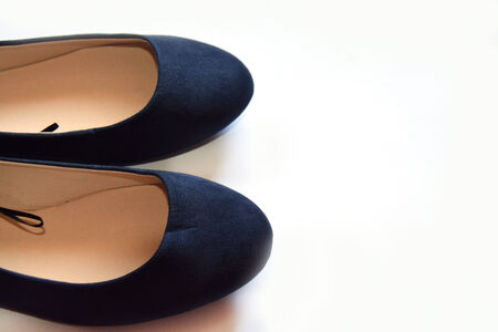partly: Two blue shoes shown partly