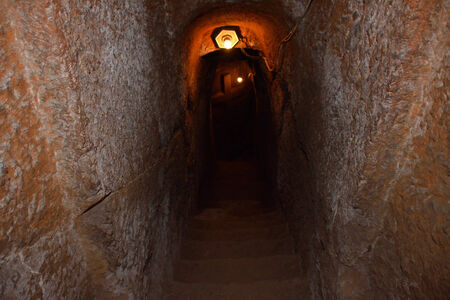 touchstone: Stairs and a cross in underground