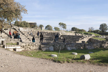 troy: Ruins of the theatre in Troy, Greece with several people