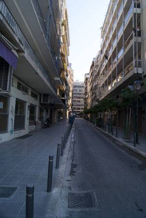 thessaloniki: Street in Thessaloniki with closed shops and motorbikes