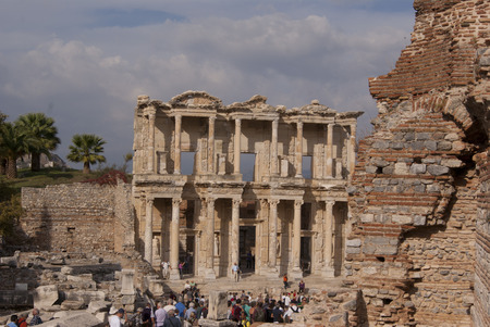 Rests of the old library in Ephesus with the crowds of tourists watching
