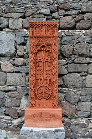 apostolic: Red stone carving with a cross (khachkar) in Geghard, Armenia