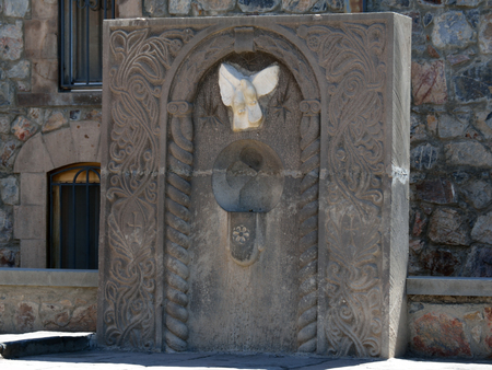 apostolic: The statue with a pair of doves and a frame with Christian symbols in Khor Virap, Armenia