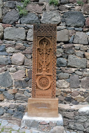 apostolic: Prolonged carved cross on the stone in Armenia