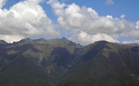 cloude: Caucasus mountains in a bright cloudy day. Krasnaya Polyana, Sochi, Russia